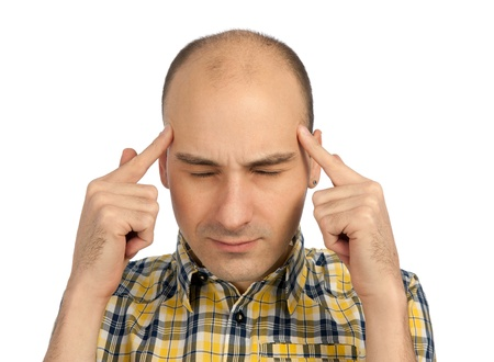 Man having headache. Isolated over white background. photo