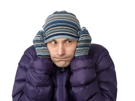 Close-up portrait of freezing young man photo