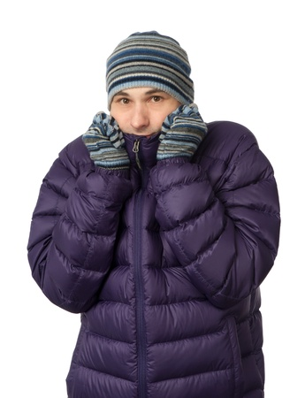 man in winter clothes shivering from the cold photo