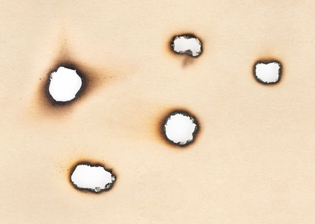Collection of Burnt Holes in old Paper photo