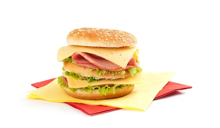 Big appetizing sandwich with lettuce, ham and cheese isolated on white background photo