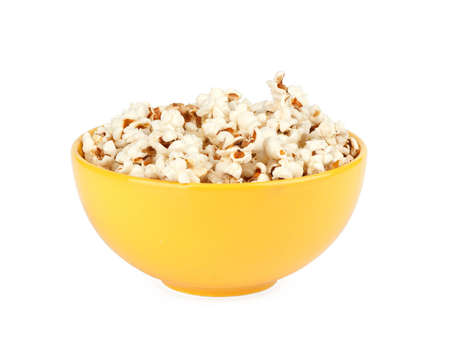popcorn in a yellow bowl isolated on white photo