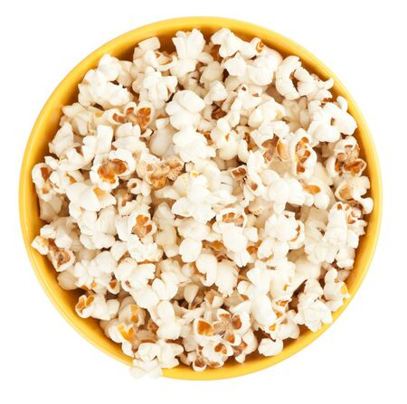 Bowl of popcorn isolated on white background. Top view