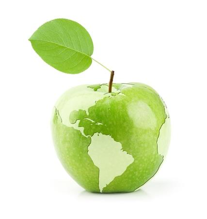 世界の地図とグリーンアップル 写真素材