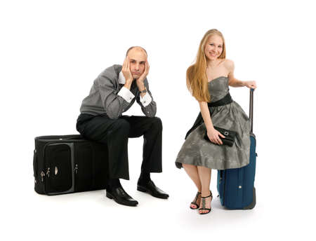 young couple with travel cases isolated on white background photo