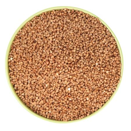 raw buckwheat in bowl isolated photo