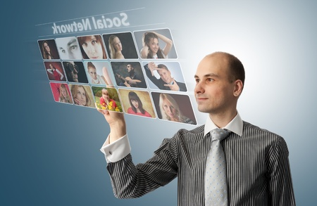 Businessman pressing social buttons on a virtual background photo