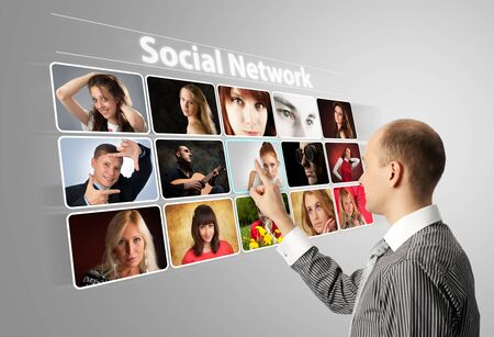 social relation: Businessman pressing social buttons on a virtual background