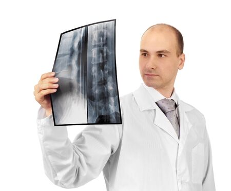Young attractive doctor studying x-ray image photo