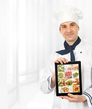 cook man showing a digital tablet with menu photo