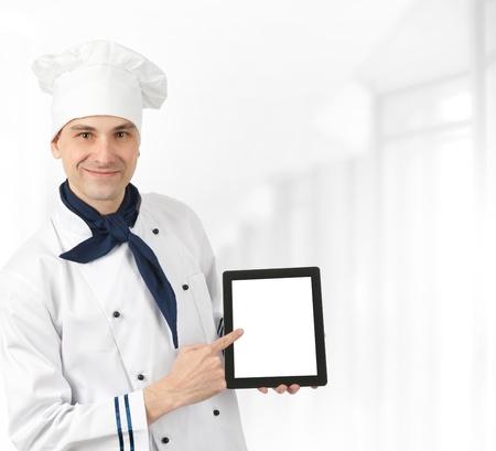 Chef presenting menu photo