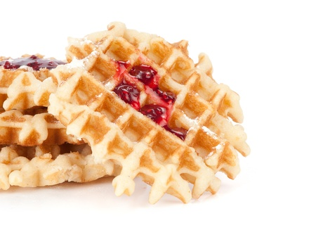 waffles with jam isolated on white photo