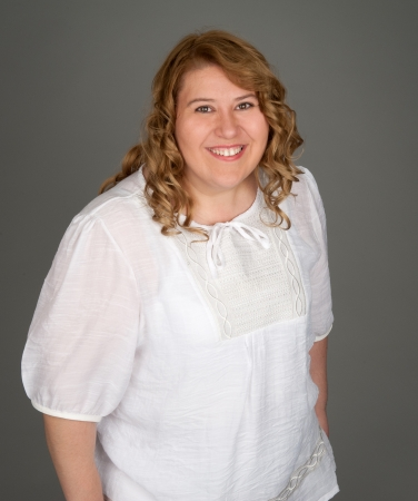 happy fat woman on gray background photo