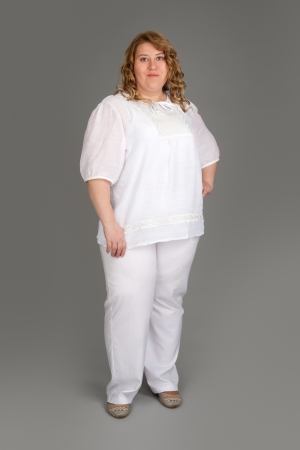 smiling fat woman on gray background Stock Photo - 13802852