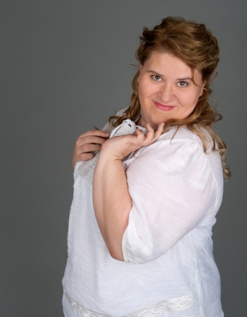 bbw: cheerful fat woman on gray background