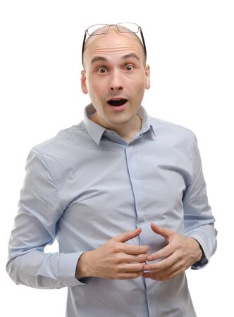 Young man with a shocked facial expression photo