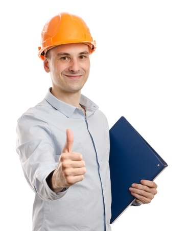 portrait of young positive manual worker thumbs up photo