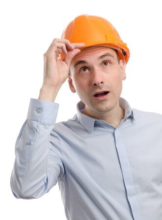 young construction worker looking up photo