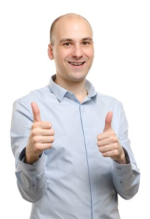 happy man gesturing thumbs up over white background