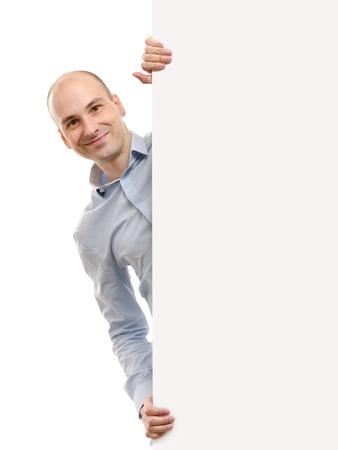 smiling handsome man posing behind a billboard photo