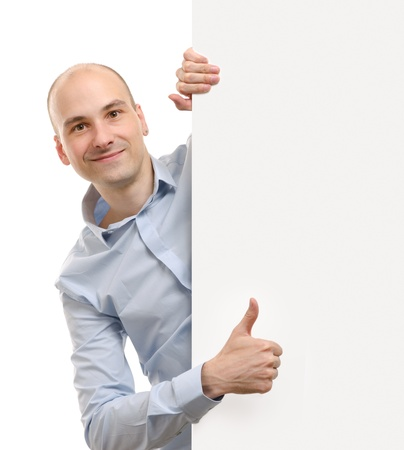 cheerful business man with blank banner showing thumbs up gesture photo