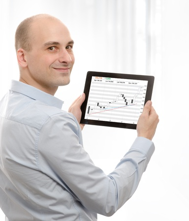 portable information device: business man using a touch screen device with Stock Quotes Stock Photo