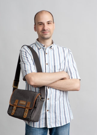 Portrait of happy smiling man with bag photo