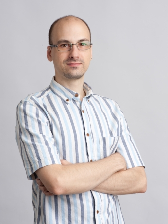 Young unshaved man with glasses photo