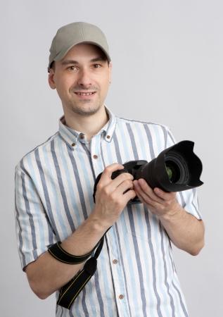Man holding professional camera photo