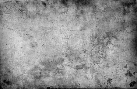 stained concrete: cracked stone wall background Stock Photo