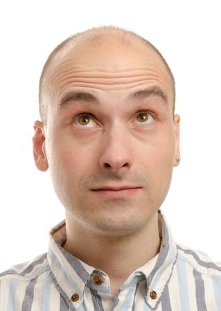 homme chauve: homme levant les yeux Banque d'images