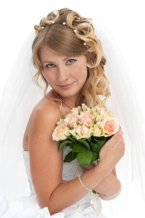 Portrait of young beautiful bride with stylish hairdo, isolated on white background photo