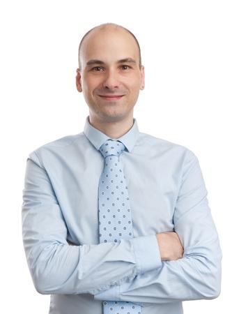 homme chauve: Jeune homme d'affaires avec les bras crois�s sur fond blanc Banque d'images