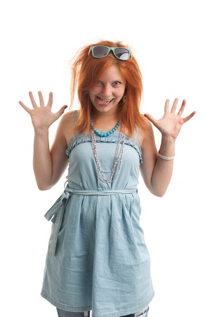 funny redhead woman shows her tongue Stock Photo