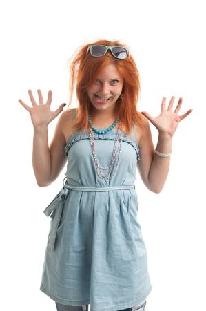 long tongue: funny redhead woman shows her tongue Stock Photo