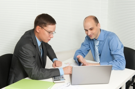 Businessmen meeting in office Stock Photo