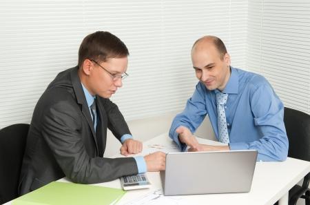 Businessmen meeting in office Foto de archivo