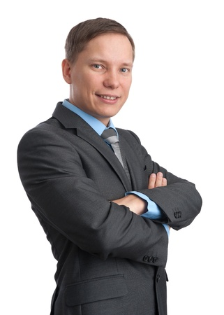 young businessman standing arms crossed photo