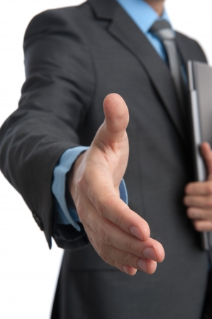 Business man gives a handshake Stock Photo