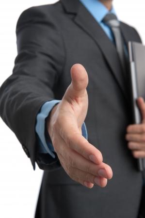Business man gives a handshake Foto de archivo