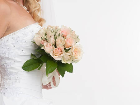 closeup of bride hands holding beautiful wedding bouquet photo
