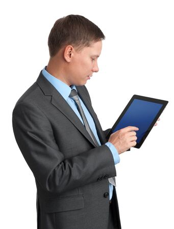 Young businessman using a tablet pc photo
