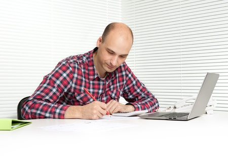 contempory: young man working at office