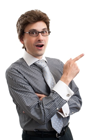 surprised Young business man pointing at something interesting on a white background photo