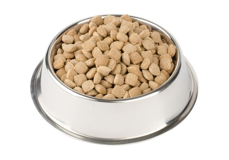 dog food: dry pet food in a metal bowl isolated on white background Stock Photo