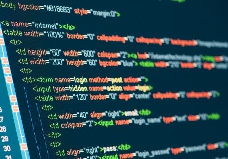 metadata: Computer codice HTML sul monitor Archivio Fotografico