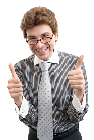 smiling young business man with thumbs up gesture, isolated over white background