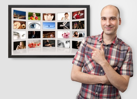 man pointing finger on digital photo album photo