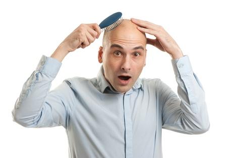 bald man: Shocked hombre calvo celebración de peine Foto de archivo
