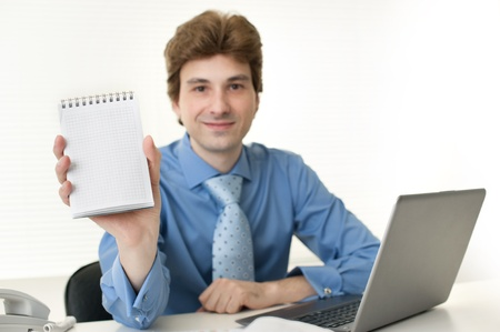 business man with note pad photo